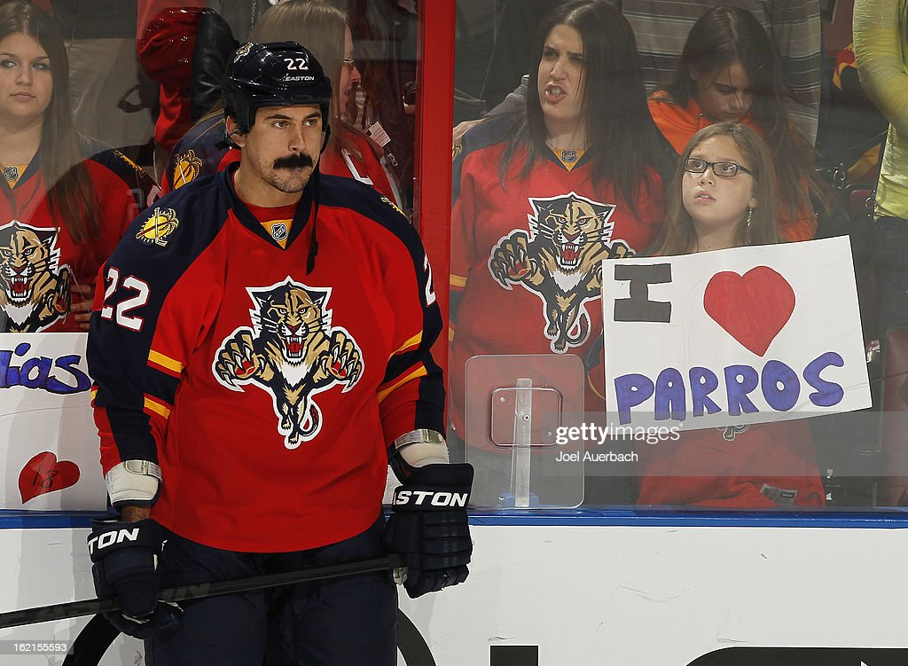 George Parros #22 of the Florida Panthers stands along the boards as fans hold a sign up for him prior to the game against the Toronto Maple Leafs at the BB&T Center on February 18, 2013 in Sunrise, Florida. The Maple Leafs defeated the Panthers 3-0.