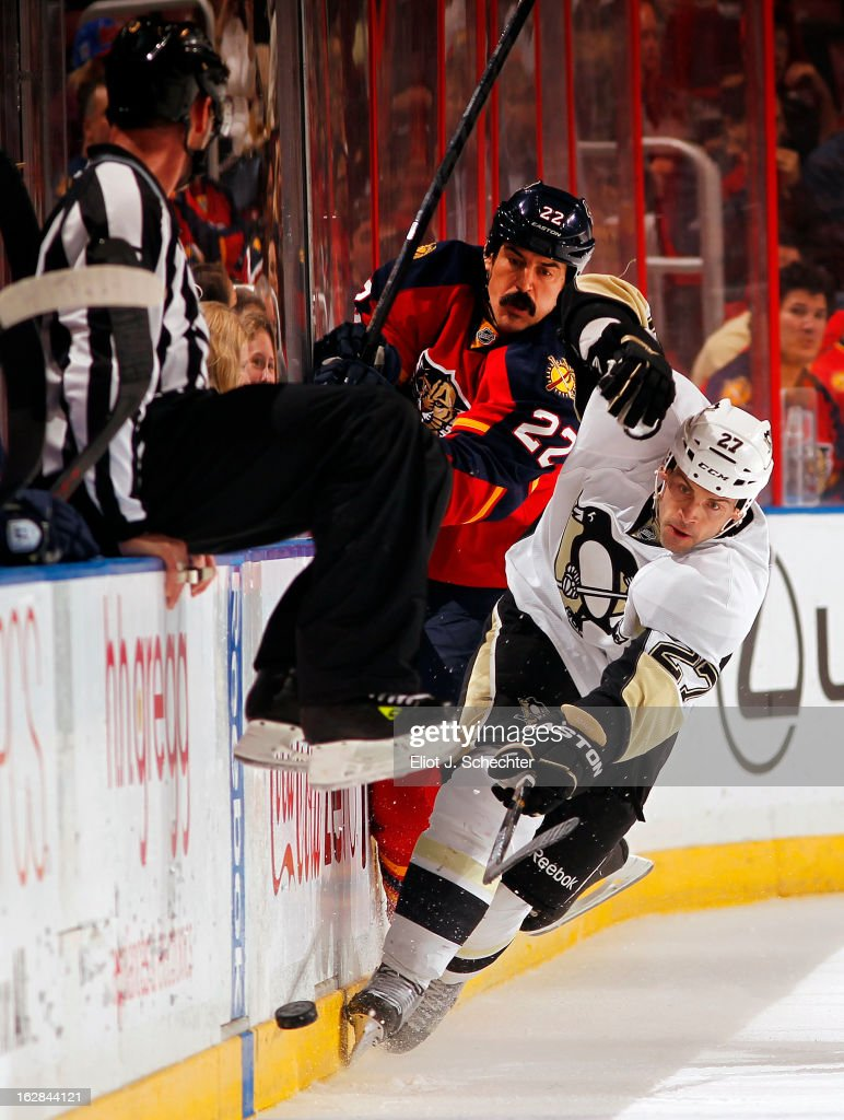 George Parros #22 of the Florida Panthers tangles with Craig Adams #27 of the Pittsburgh Penguins at the BB&T Center on February 26, 2013 in Sunrise, Florida.