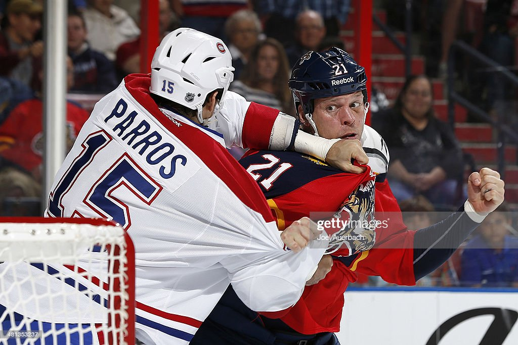 <a gi-track='captionPersonalityLinkClicked' href=/galleries/search?phrase=George+Parros&family=editorial&specificpeople=557239 ng-click='$event.stopPropagation()'>George Parros</a> #15 of the Montreal Canadiens and <a gi-track='captionPersonalityLinkClicked' href=/galleries/search?phrase=Krys+Barch&family=editorial&specificpeople=2538220 ng-click='$event.stopPropagation()'>Krys Barch</a> #21 of the Florida Panthers fight during first period action at the BB&T Center on March 29, 2014 in Sunrise, Florida.
