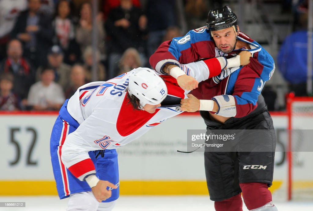 <a gi-track='captionPersonalityLinkClicked' href=/galleries/search?phrase=George+Parros&family=editorial&specificpeople=557239 ng-click='$event.stopPropagation()'>George Parros</a> #15 of the Montreal Canadiens and <a gi-track='captionPersonalityLinkClicked' href=/galleries/search?phrase=Patrick+Bordeleau&family=editorial&specificpeople=2282247 ng-click='$event.stopPropagation()'>Patrick Bordeleau</a> #58 of the Colorado Avalanche engage in a fight in the first period at Pepsi Center on November 2, 2013 in Denver, Colorado.