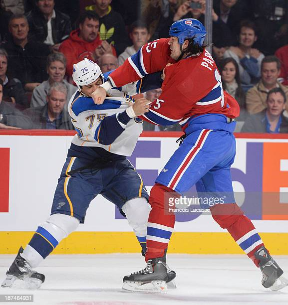 George Parros of the Montreal Canadiens fights against Ryan Reaves of the St Louis Blues during the NHL game on November 5 2013 at the Bell Centre in...