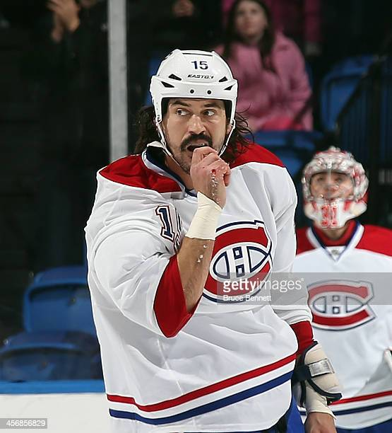 George Parros of the Montreal Canadiens leaves the ice following his fight with Eric Boulton of the New York Islanders during the first period at the...