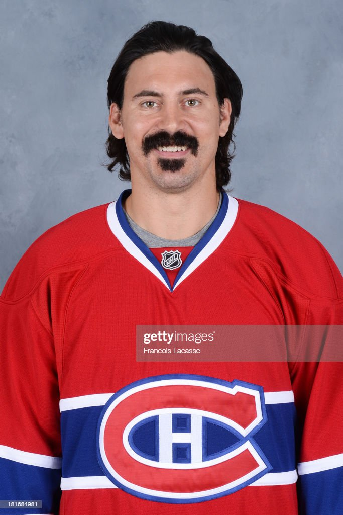 <a gi-track='captionPersonalityLinkClicked' href=/galleries/search?phrase=George+Parros&family=editorial&specificpeople=557239 ng-click='$event.stopPropagation()'>George Parros</a> of the Montreal Canadiens poses for his official headshot for the 2013-2014 season on September 11, 2013 at the Bell Sports Complex in Brossard, Quebec, Canada.