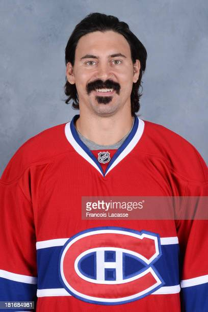 George Parros of the Montreal Canadiens poses for his official headshot for the 20132014 season on September 11 2013 at the Bell Sports Complex in...