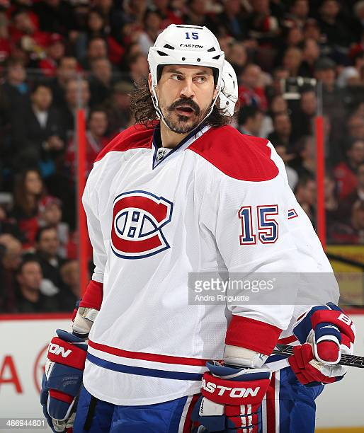 George Parros of the Montreal Canadiens skates against the Ottawa Senators at Canadian Tire Centre on January 16 2014 in Ottawa Ontario Canada