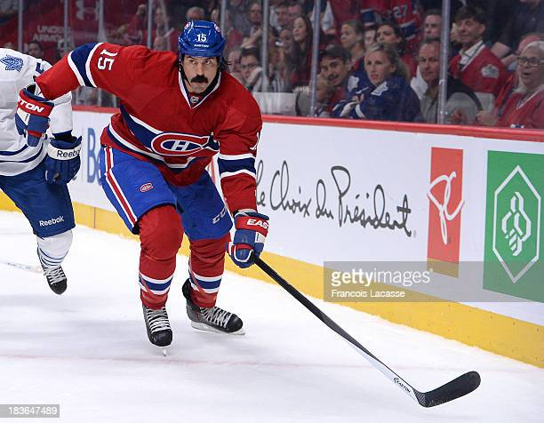 George Parros of the Montreal Canadiens skates against the Toronto Maple Leafs during the NHL game on October 1 2013 at the Bell Centre in Montreal...