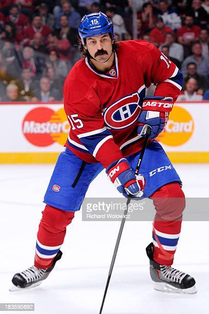 George Parros of the Montreal Canadiens skates during the NHL game against the Toronto Maple Leafs at the Bell Centre on October 1 2013 in Montreal...