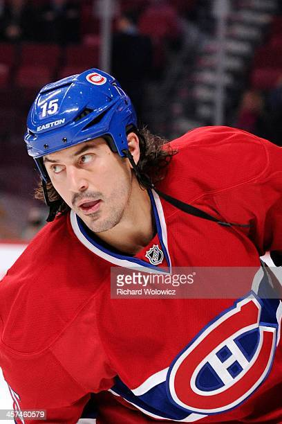George Parros of the Montreal Canadiens skates during the warm up period prior to facing the StLouis Blues in their NHL game at the Bell Centre on...