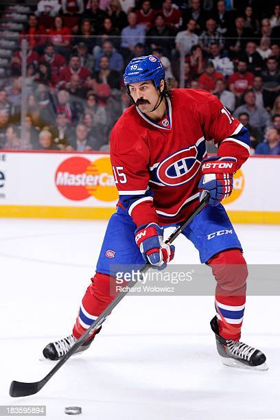 George Parros of the Montreal Canadiens skates with the puck during the NHL game against the Toronto Maple Leafs at the Bell Centre on October 1 2013...