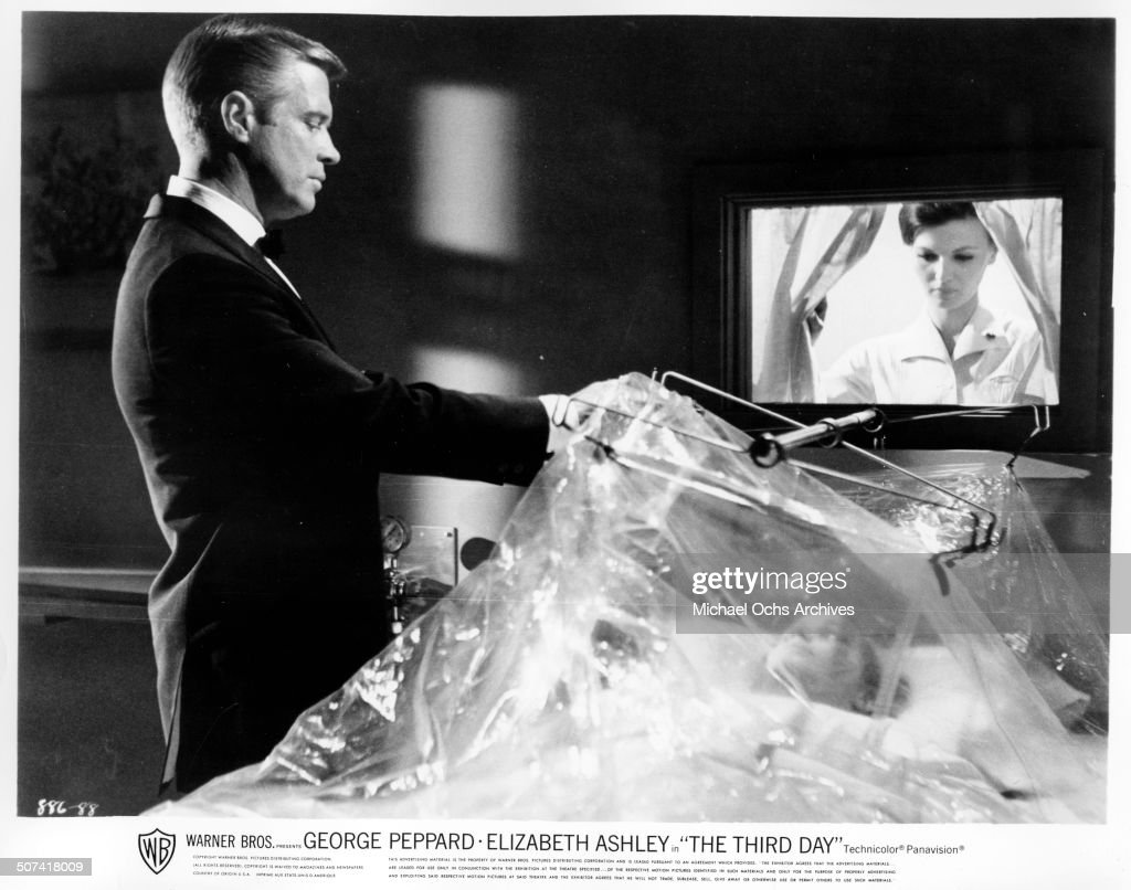 George Peppard look at dieing Sally Kellerman in a scene from the Warner Bros movie 'The Third Day' circa 1965