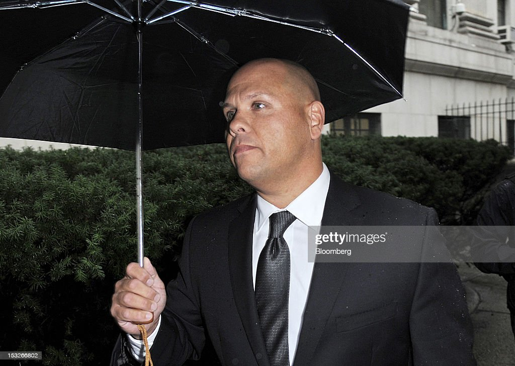 George Perez, a former employee at Bernard L. Madoff Investment Securities LLC, exits federal court in New York, U.S., on Tuesday, Oct. 2, 2012. Five longtime employees of Bernard Madoff's former investment firm face more charges related to the jailed con man's Ponzi scheme, which the government claims got its start in the 1970s. Photographer: Peter Foley/Bloomberg via Getty Images