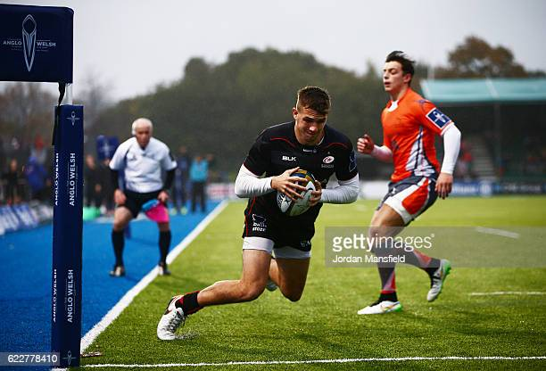 George Perkins of Saracens touches down a try during the AngloWelsh Cup between Saracens and Newcastle Falcons at Allianz Park on November 12 2016 in...