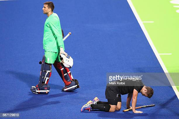 George Pinner of Great Britain walks away as Nick Wilson New Zealand tries to get to his feet after a heavy collision during the men's pool A match...