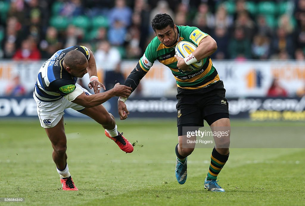 George Pisi of Northampton is tackled by Jonathan Joseph during the Aviva Premiership match between Northampton Saints and Bath at Franklin's Gardens on April 30, 2016 in Northampton, England.