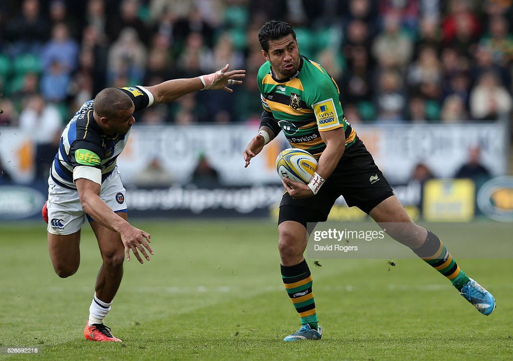 <a gi-track='captionPersonalityLinkClicked' href=/galleries/search?phrase=George+Pisi&family=editorial&specificpeople=783455 ng-click='$event.stopPropagation()'>George Pisi</a> of Northampton is tackled by <a gi-track='captionPersonalityLinkClicked' href=/galleries/search?phrase=Jonathan+Joseph+-+Rugby+Player&family=editorial&specificpeople=11460526 ng-click='$event.stopPropagation()'>Jonathan Joseph</a> during the Aviva Premiership match between Northampton Saints and Bath at Franklin's Gardens on April 30, 2016 in Northampton, England.