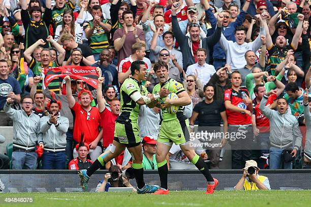 George Pisi of Northampton Saints congratulates Ben Foden of Northampton Saints on scoring their first try during the Aviva Premiership Final between...