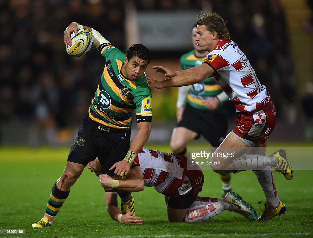 George Pisi of Northampton Saints is tackled by Willi Heinz and Billy Twelvetrees of Gloucester Rugby during the Aviva Premiership match between Northampton Saints and Gloucester Rugby at Franklin's Gardens on November 27, 2015 in Northampton, England.
