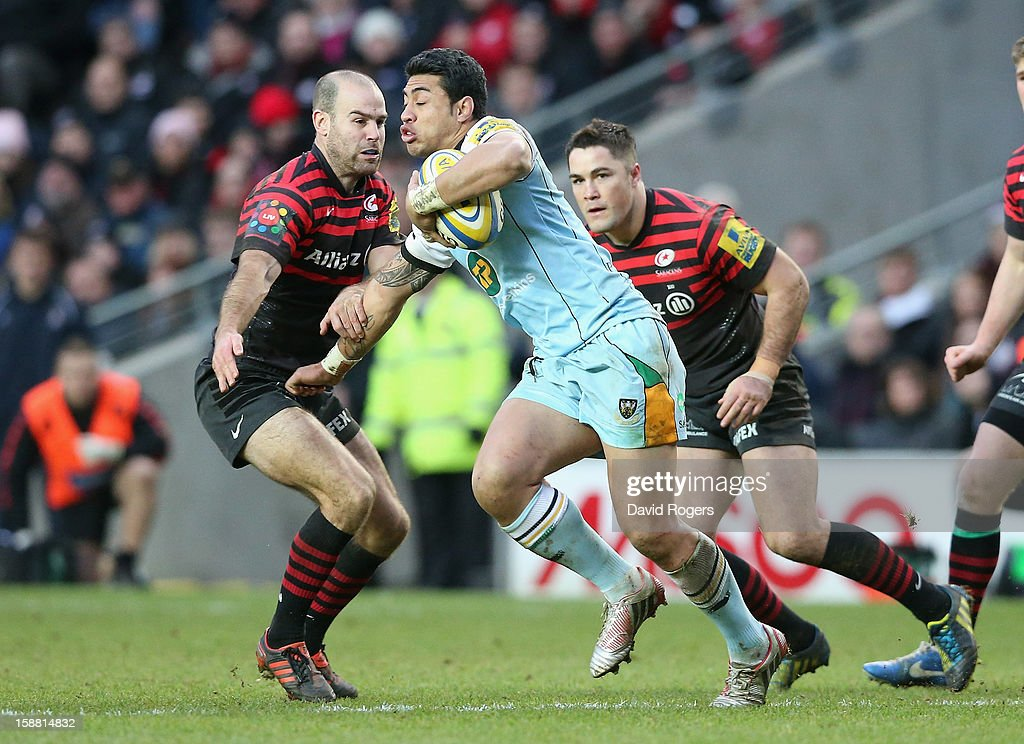 <a gi-track='captionPersonalityLinkClicked' href=/galleries/search?phrase=George+Pisi&family=editorial&specificpeople=783455 ng-click='$event.stopPropagation()'>George Pisi</a> of Northampton takes on <a gi-track='captionPersonalityLinkClicked' href=/galleries/search?phrase=Charlie+Hodgson&family=editorial&specificpeople=202536 ng-click='$event.stopPropagation()'>Charlie Hodgson</a> during the Aviva Premiership match between Saracens and Northampton Saints at stadiumMK on December 30, 2012 in Milton Keynes, England.