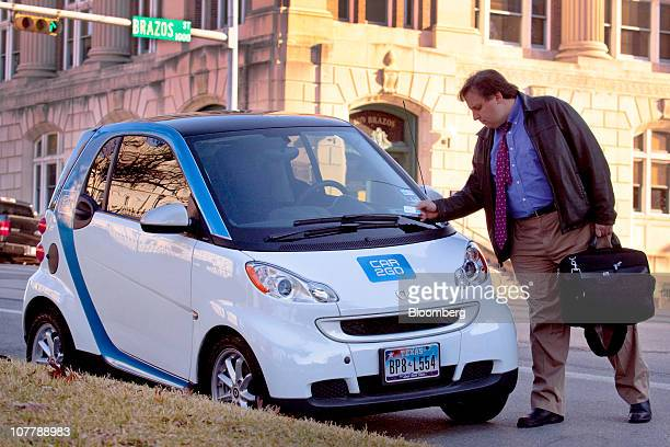 George Purcell Jr an analyst for the Texas Legislative Budget Board parks a Daimler AG Smart car that is part of the Car2go auto sharing program in...