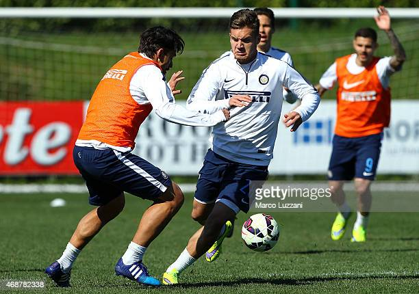 George Puscas competes for the ball with Felipe Dal Belo during FC Internazionale training session at the club's training ground on April 7 2015 in...