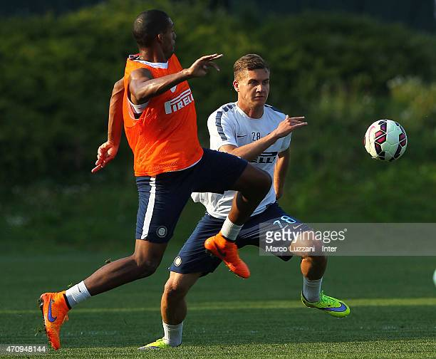George Puscas competes with Juan Guilherme Nunes Jesus during FC Internazionale training session at the club's training ground on April 24 2015 in...