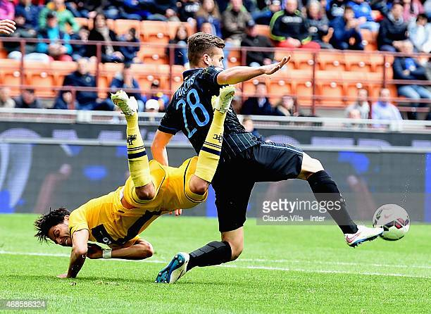 George Puscas of FC Internazionale and Pedro Mendes of Parma FC compete for the ball during the Serie A match between FC Internazionale Milano and...