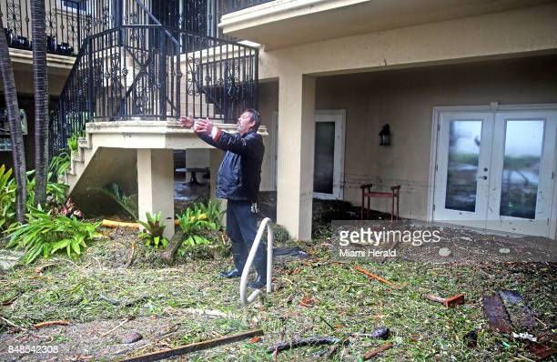 George Ramos explains the level of the surge in the house he is a caretaker for on Sunday Sept 10 2017 after Hurricane Irma swept a 10foot surge onto...