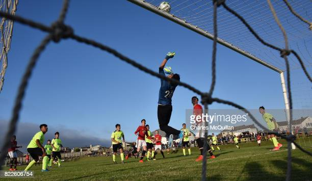 George Ray Wyatt of Manchester United sees his header saved by Cristofer Rios of Colina during the NI Super Cup junior section game between...