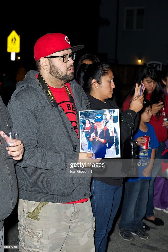 George Reyes holds a photo of Jenni Rivera at a Candlelight Vigil in her honor on December 10, 2012 in Long Beach, California.