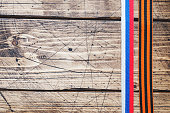 George ribbon and Ribbon with Russian flag tricolor on wooden background. Symbol may 9, victory day. Copy space.