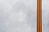 George ribbon on a concrete background. Symbol may 9, victory day. Copy space.