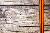 George ribbon on wooden background. Symbol may 9, victory day. Copy space.