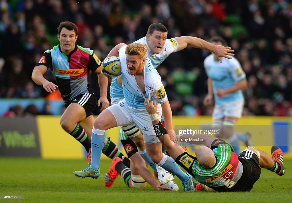 <a gi-track='captionPersonalityLinkClicked' href=/galleries/search?phrase=George+Robson+-+Rugby+Player&family=editorial&specificpeople=11374681 ng-click='$event.stopPropagation()'>George Robson</a> of Harlequins tackles Tom Catterick of Newcastle Falcons during the Aviva Premiership match between Harlequins and Newcastle Falcons at the Twickenham Stoop on December 20, 2014 in London, England.