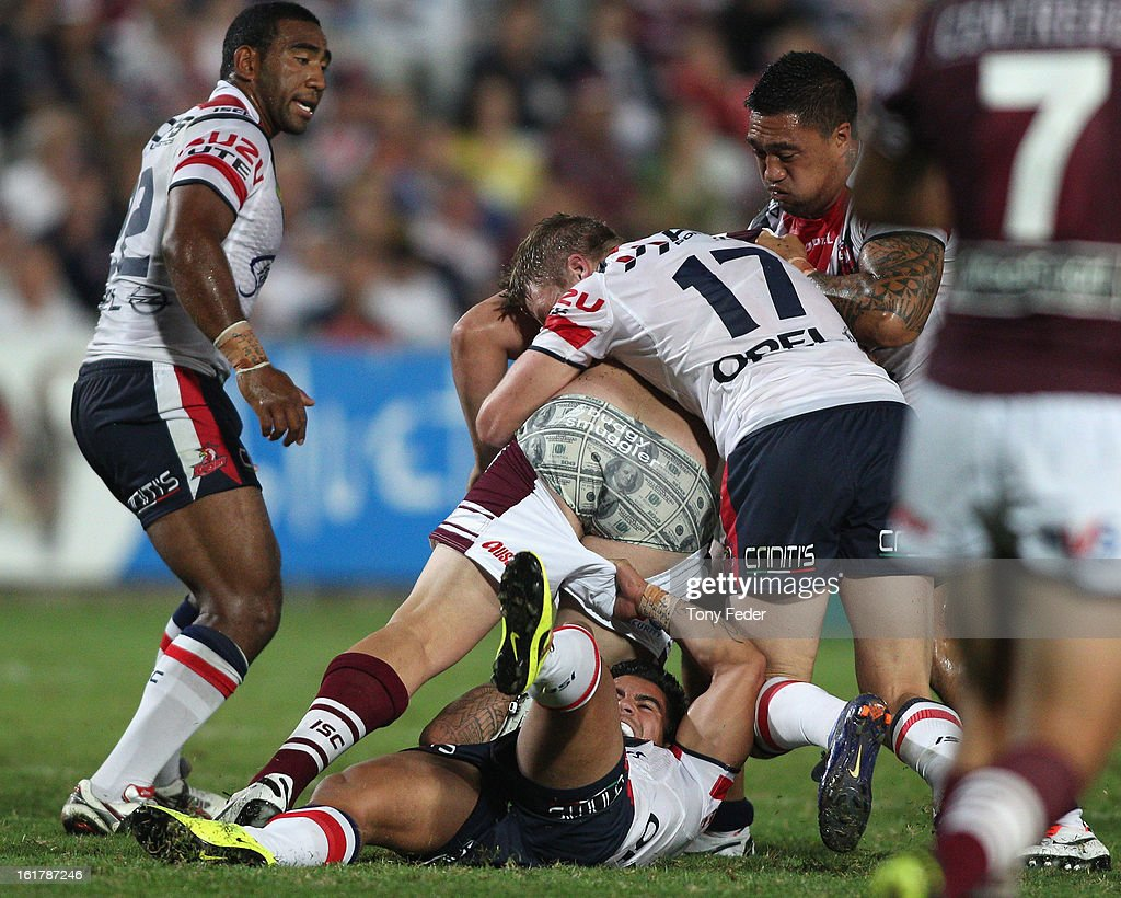 George Rose of the Sea Eagles has his shorts pulled during the NRL trial match between the Manly Sea Eagles and the Sydney Roosters at Bluetongue Stadium on February 16, 2013 in Gosford, Australia.