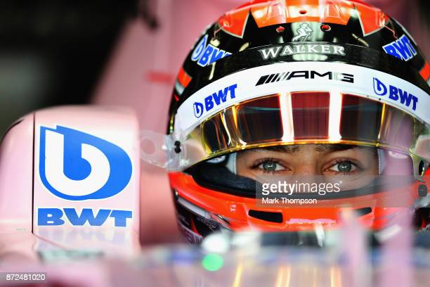 George Russell of Great Britain and Force India prepares to drive in the garage during practice for the Formula One Grand Prix of Brazil at Autodromo...
