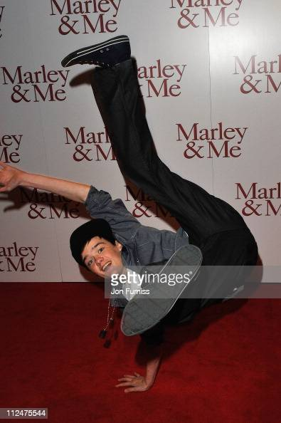 George Sampson arrives and does a dance move at the UK premiere of Marley Me at the Vue Leicester Square on March 2 2009 in London England