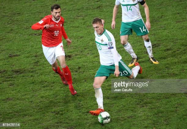 George Saville of Northern Ireland Admir Mehmedi of Switzerland during the FIFA 2018 World Cup Qualifier PlayOff Second Leg between Switzerland and...