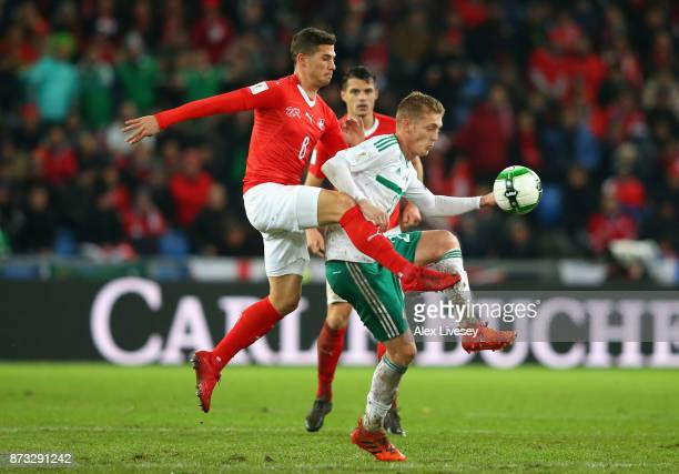 George Saville of Northern Ireland and Remo Freuler of Switzerland in action during the FIFA 2018 World Cup Qualifier PlayOff Second Leg between...