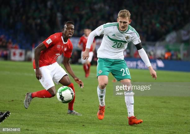 George Saville of Northern Ireland Denis Zakaria of Switzerland during the FIFA 2018 World Cup Qualifier PlayOff Second Leg between Switzerland and...