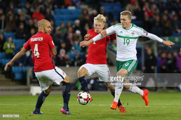George Saville of Northern Ireland in action against Tore Reginiussen and Birger Meling of Norway during the FIFA 2018 World Cup Qualifier between...