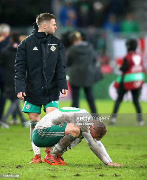 George Saville of Northern Ireland is consoled by Oliver Norwood of Northern Ireland following the FIFA 2018 World Cup Qualifier PlayOff Second Leg...