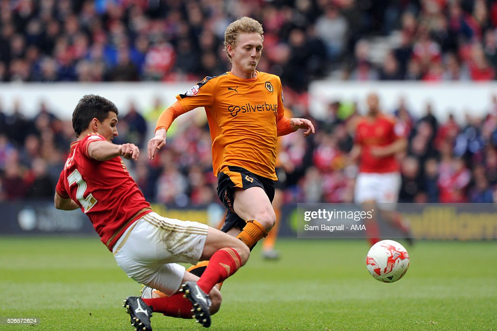 George Saville of Wolverhampton Wanderers and Eric Lichaj of Nottingham Forest during the Sky Bet Championship match between Nottingham Forest and Wolverhampton Wanderers on April 30, 2016 in Nottingham, United Kingdom.