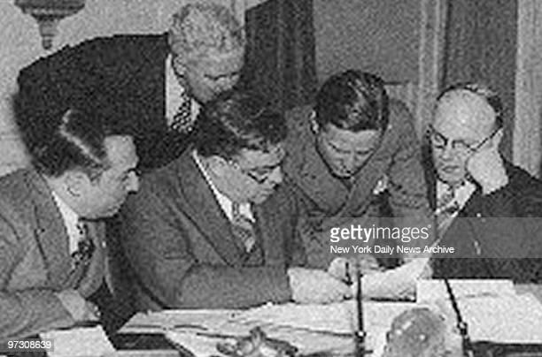 George Scalise Mayor La Guardia and James J Bambrick read the Elevator Strike ageement