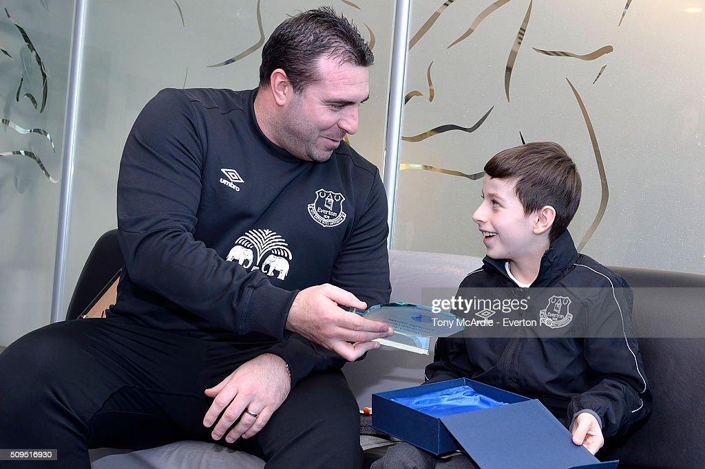 George Shaw meets David Unsworth after being presented the Everton goal of the month award at Finch Farm on February 11, 2016 in Halewood, England.