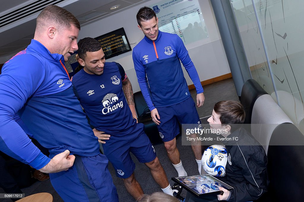 George Shaw meets Ross Barkley (L) Aaron Lennon (C) and Kevin Mirallas (R) after being presented the Everton goal of the month award at Finch Farm on February 11, 2016 in Halewood, England.