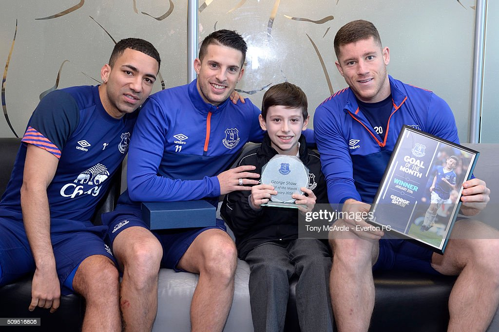 George Shaw meets Ross Barkley, Kevin Mirallas and Aaron Lennon after being presented the Everton goal of the month award at Finch Farm on February 11, 2016 in Halewood, England.
