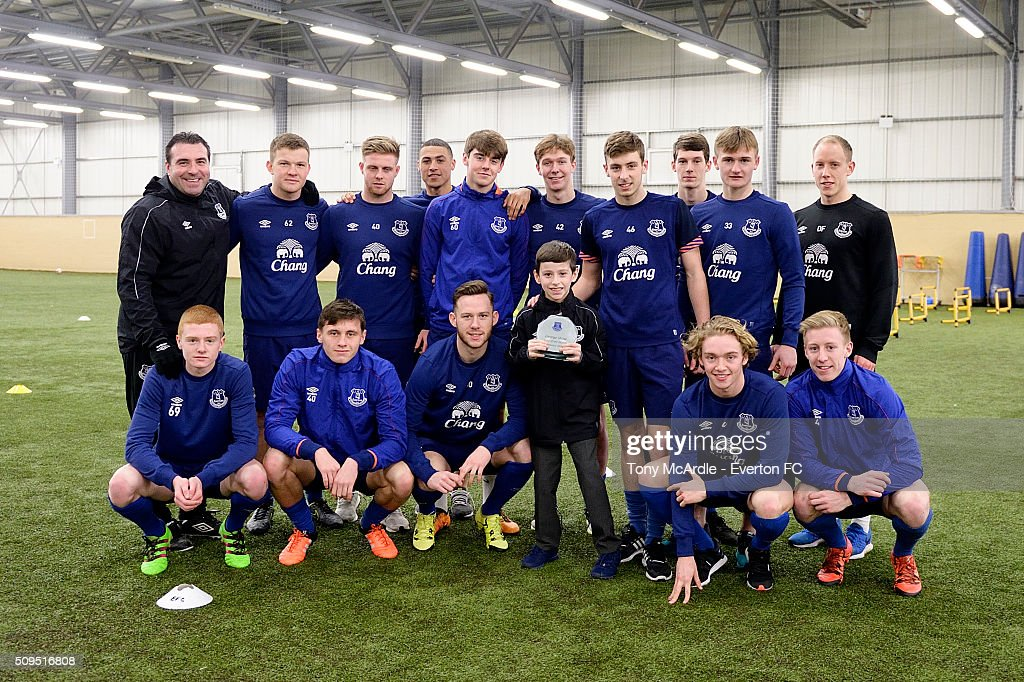 George Shaw meets the Everton Under 21 team after being presented the Everton goal of the month award at Finch Farm on February 11, 2016 in Halewood, England.