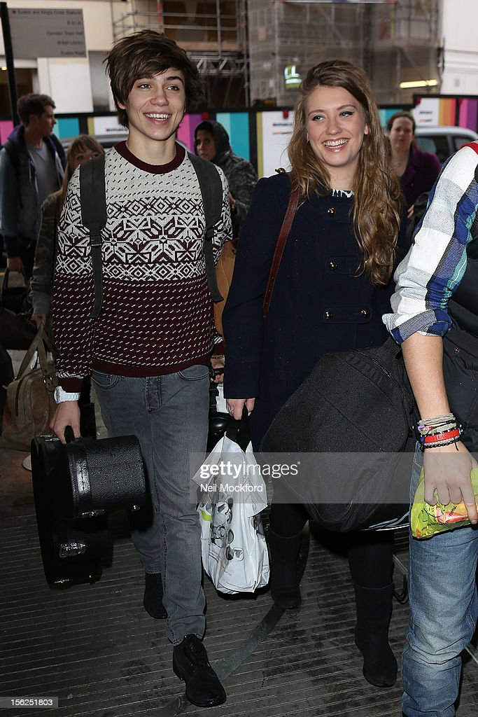 George Shelley and Ella Henderson from X Factor 2012 seen at Kings Cross St Pancras Eurostar on November 12, 2012 in London, England.