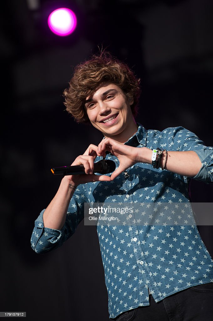 George Shelley of Union J performs on stage on Day 1 of Fusion Festival 2013 at Cofton Park on August 31, 2013 in Birmingham, England.