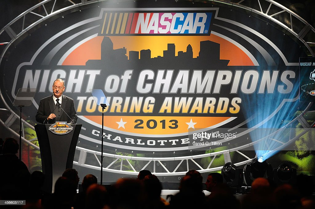 George Silbermann, NASCAR vice president of touring and weekly series, speaks during the NASCAR Night of Champions at Charlotte Convention Center on December 14, 2013 in Charlotte, North Carolina.